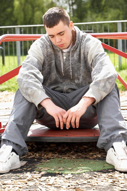 Sad teen in playground