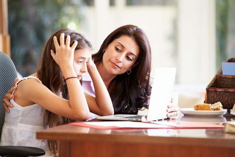 Mother helping stressed daughter